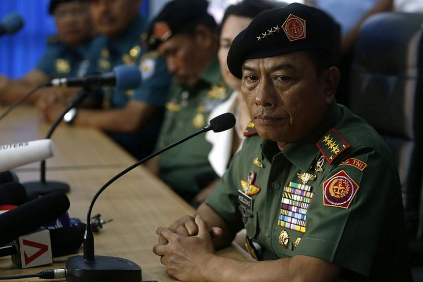 "Indonesia's chief of armed forces, General Moeldoko, told reporters that he saw for himself that ""the environment is not easy"", but that ""our men are working very hard and risking our lives"". -- PHOTO: REUTERS"