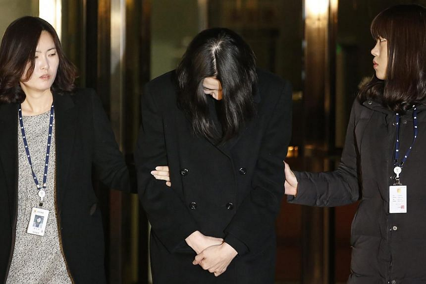 Cho Hyun Ah (centre), also known as Heather Cho, daughter of Korean Airlines chairman Cho Yang Ho, leaves for a detention facility after a Korean court ordered her to be detained, at the Seoul Western District Prosecutor's office on Dec 30, 2014.&n