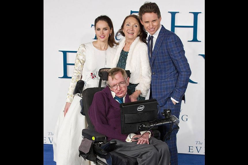 British scientist Stephen Hawking (front) at the UK premiere of The Theory Of Everything with (back row from left) actress Felicity Jones, his ex-wife Jane Wilde and the actor who plays him, Eddie Redmayne. -- PHOTO: AGENCE FRANCE-PRESSE