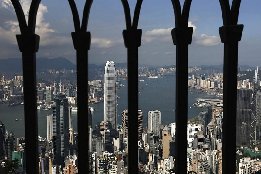 Hong Kong's home prices hit a record high for a seventh consecutive month in November as pent-up demand for smaller units continued to boost sales. -- PHOTO:REUTERS