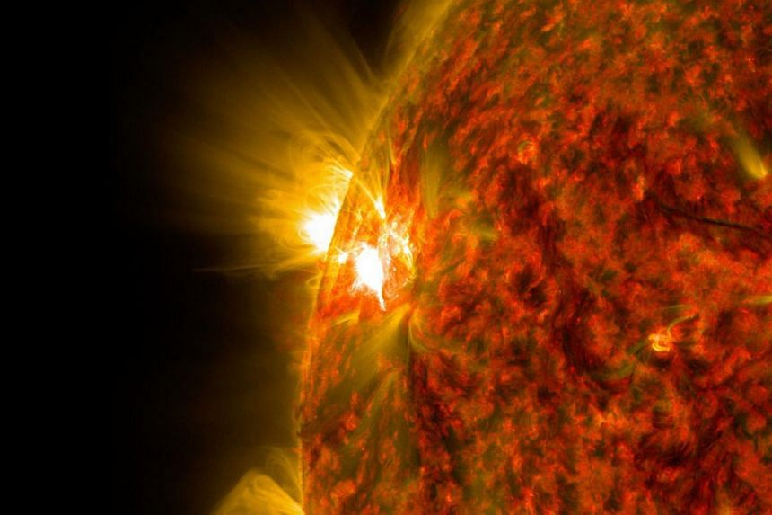 An active region on the sun as it emitted a mid-level solar flare in a handout image by NASA obtained on Nov 6, 2014. In an unusual study, Norwegian scientists said people born during periods of solar calm may live longer than those who enter the wor