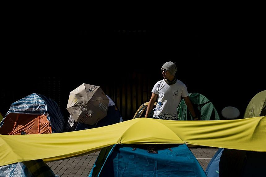 A pro-democracy supporter looking the last few tents allowed to remain outside the government building in Hong Kong on Jan 6, 2015. Hong Kong will take the next step in its contentious political reform process on Wednesday when the government unveils