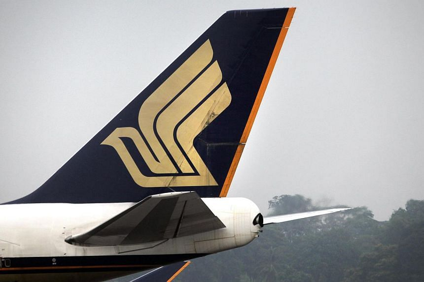 A Singapore Airlines flight preparing to take off from Changi Airport's Terminal 3 had to taxi back to the gates on Wednesday morning, after its pilots received a technical fault message. -- PHOTO: ST FILE
