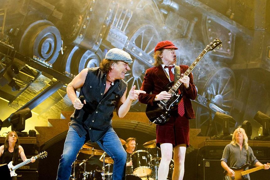 Rock band AC/DC lead guitarist Angus Young (right) and vocalist Brian Johnson perform during a concert at the Telenor Arena in Fornebu, near Oslo, in February, 2009. The Veteran Australian band will headline the first night of this year's Coachella V