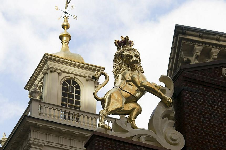 The newly-installed statue of a lion is seen on top of the Old State House in Boston, Massachusetts, in November last year. A time capsule was discovered in the head of the lion when it was removed for cleaning, and a new time capsule was placed in t
