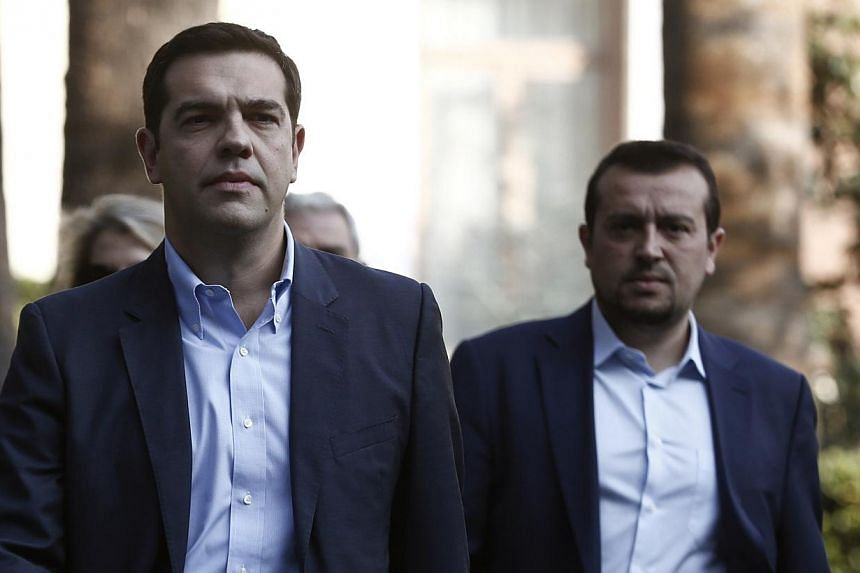 Alexis Tsipras (centre), leader of Greece's far-left Syriza party, leaves the Presidential palace in Athens in this file photo. The first sign of obvious trouble could come from Greece, where the populist left-leaning Syriza could win a snap election