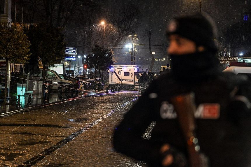 A police officer stands guard along a street leading to a police station where a female suicide bomber was killed on Jan 6, 2015.A female suicide bomber on Tuesday blew herself up in the most-visited tourist district of Istanbul, killing hersel