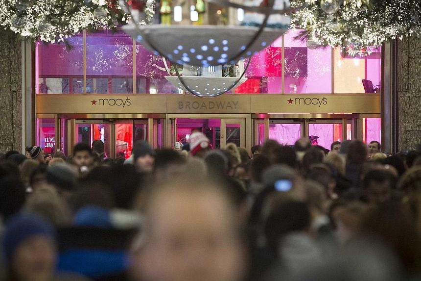 Shoppers waiting for a Macy's store in in New York to open on Nov. 27, 2014, the day before Black Friday. Scattered spending and early discounts led to a slow start to the holiday season, which coupled with a weak Black Friday weekend, resulted