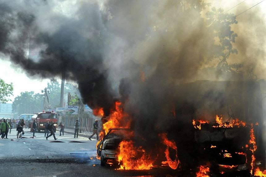 Burning vehicles, set on fire by opposition demonstrators, are pictured during violent protests in Dhaka on Jan 6, 2015.A political crisis in Bangladesh deepened on Thursday, after two more people died in a crackdown on anti-government proteste