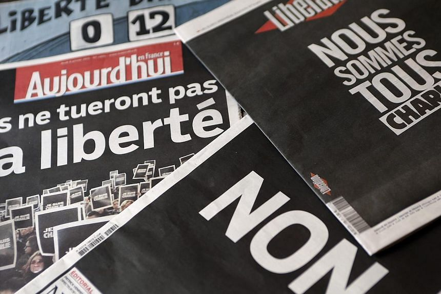 An illustration photo shows the front pages of daily papers displayed in an office in Bordeaux, on Jan 8, 2015, the day after a shooting at the Paris offices of weekly satirical newspaper Charlie Hebdo. Long plagued by deep political divisions a