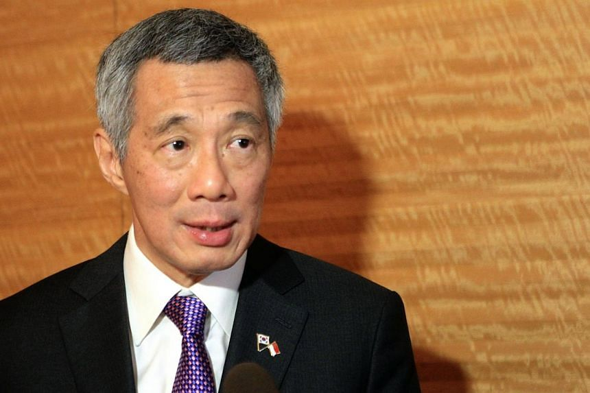 Singapore strongly condemns the deadly attack on French magazine Charlie Hebdo which killed 12 people, said Prime Minister Lee Hsien Loong. -- PHOTO: ZAOBAO