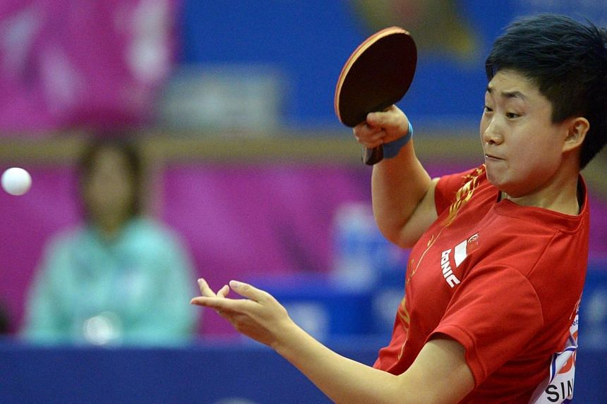 Singapore'sFeng Tianwei and Co. opened their campaign at the International Table Tennis Federation World Team Cup in Dubai with a clinical 3-0 victory over hosts United Arab Emirates (UAE) on Thursday. -- PHOTO: ST FILE