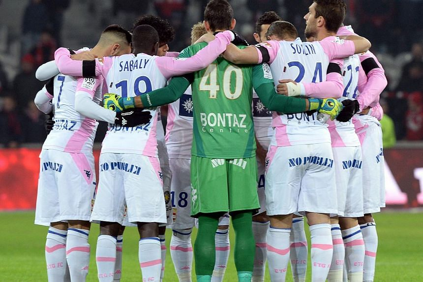A minute's silence will be observed at football grounds throughout France this weekend as a mark of respect for the 12 people killed in the terrorist attack on the Charlie Hebdo satirical newspaper, the French Football Federation (FFF) announced on T