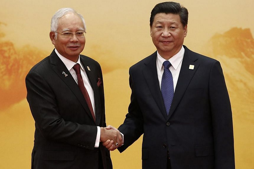 Malaysian Prime Minister Najib Razak with Chinese President Xi Jinping. Malaysia has maintained friendly relations with China, and as Asean chairman could facilitate progress in talks over disputes in the South China Sea. -- PHOTO: REUTERS