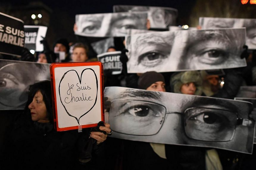 People gather on Union Square on Jan 7, 2015 in New York in memory of the victims of the attack on the offices of the satirical weekly Charlie Hebdo in Paris. -- PHOTO: AFP