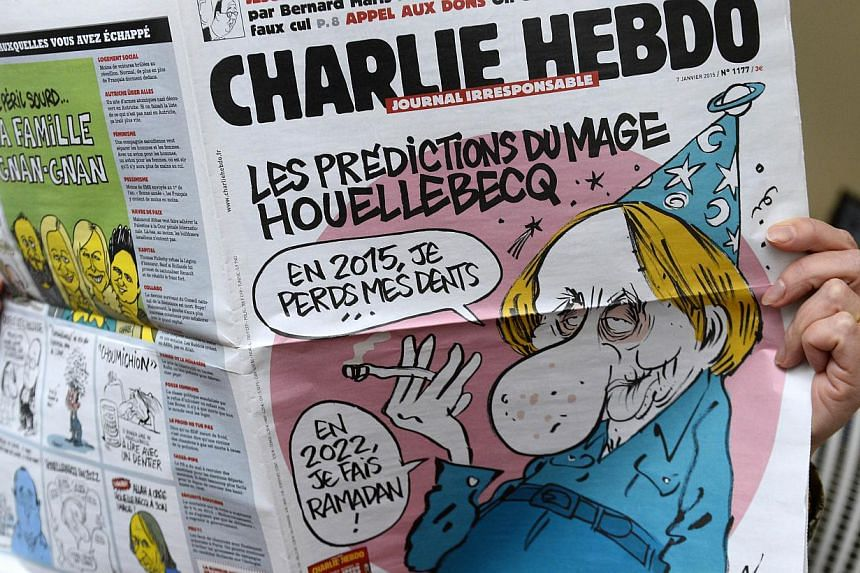 A person reads the latest issue of the French satirical newspaper Charlie Hebdo in Paris on Jan 7, 2015, after gunmen armed with Kalashnikovs and a rocket-launcher opened fire in the offices of the weekly in Paris. -- PHOTO: AFP