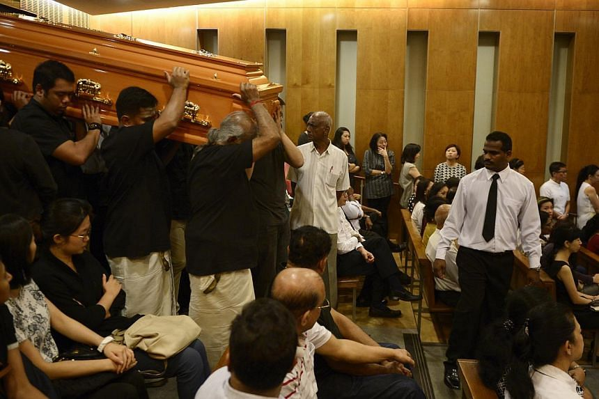 Pallbearers carrying the coffin containing the body of the late Subhas Anandan during his funeral held at Mandai Crematorium on 8 Jan, 2015. -- ST PHOTO: MARK CHEONG
