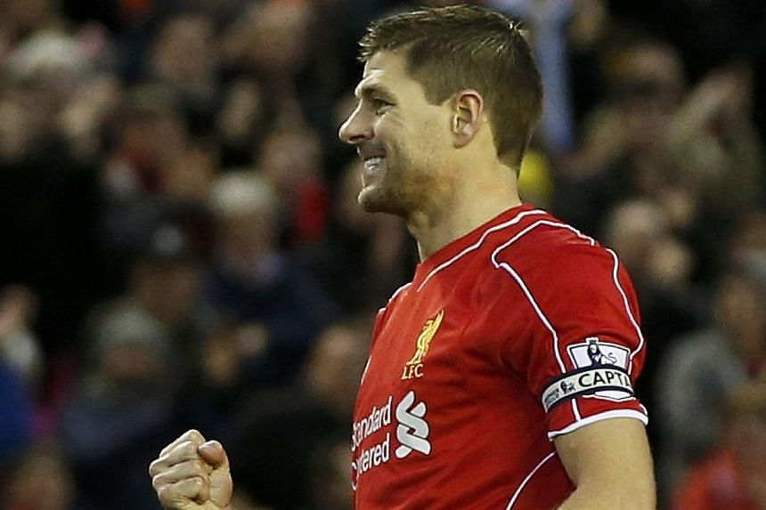 Liverpool's Steven Gerrard celebrates his goal after scoring a penalty during their English Premier League soccer match against Leicester City at Anfield in Liverpool, northern England Jan 1, 2015. The Los Angeles Galaxy confirmed on Wednesday that L
