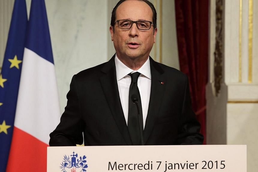 French President Francois Hollande delivers a speech at the Elysee Palace after a shooting at the Paris headquarters of satirical weekly Charlie Hebdo killing at least 12 people and injuring many, Jan 7, 2015. -- PHOTO: REUTERS