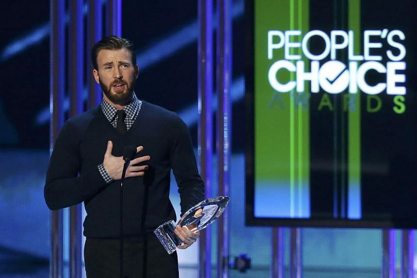 Chris Evans accepting the award for favourite action movie actor. -- PHOTO: REUTERS