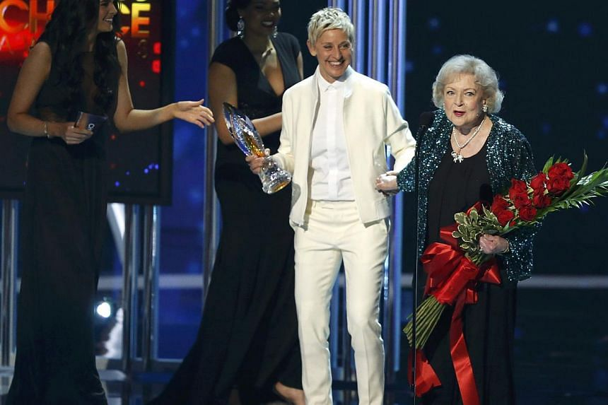 Actress Betty White accepting the favourite TV Icon award from presenter Ellen DeGeneres. -- PHOTO: REUTERS