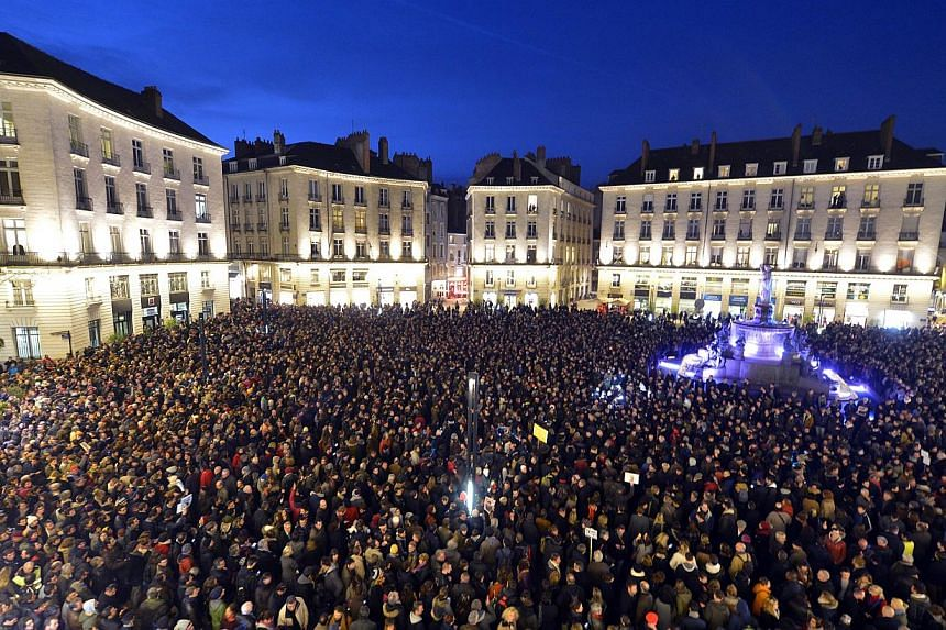 People gathering at the Place Royale in Nantes, France, on Jan 7, 2015, to show their solidarity for the victims of the attack by unknown gunmen on the offices of the satirical weekly, Charlie Hebdo. -- PHOTO: AFP