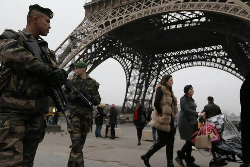 French soldiers on patrol near the Eiffel Tower in Paris, after a shooting at the Paris offices of Charlie Hebdo Jan 7, 2015. Troops in railway stations, armed police outside media buildings, ultra-tight security at department stores: Paris beca