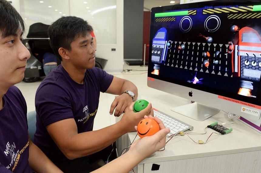 (From left) Lliow Teck Meng, 26, and Raynard Hadiwidjaja, 20, are among a team of students from Ngee Ann Polytechnic Information Technology and Multimedia Animation courses who have developed a stress ball physiotherapy system that integrates convent