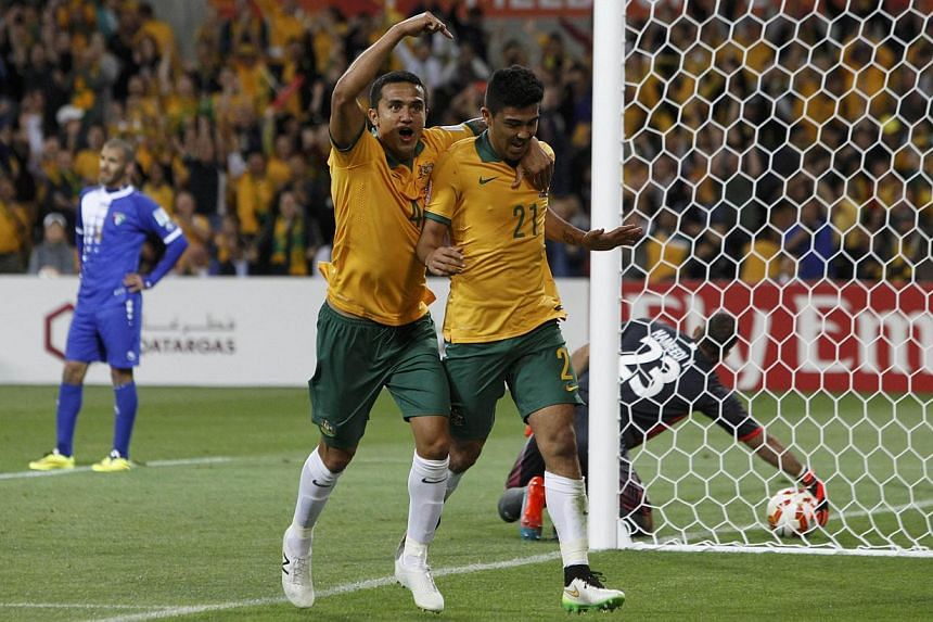 Australia's Massimo Luongo (right) celebrates his goal with teammate Tim Cahill during their Asian Cup Group A soccer match against Kuwait at the Rectangular stadium in Melbourne on Jan 9, 2015.Hosts Australia showed impressive firepower to bea