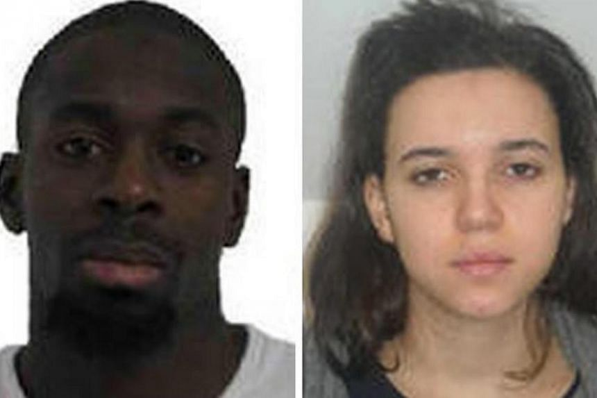 A composite image of two handout pictures released by French Police in Paris on Jan 9, 2015, shows Amedy Coulibaly (left) and Hayat Boumeddiene, suspects in connection with the shooting attack on Jan 8, 2015, in Montrouge, France. -- PHOTO: EPA/