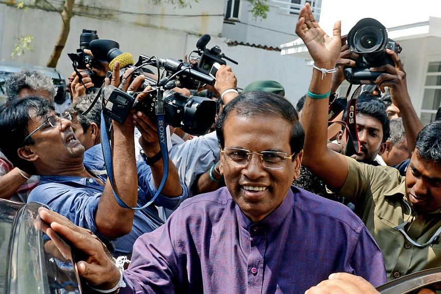 Sri Lanka's newly elected president Maithripala Sirisena leaves the opposition leader's office after meeting with political leaders who supported him, in the capital Colombo on Jan 9, 2015. -- PHOTO: AFP