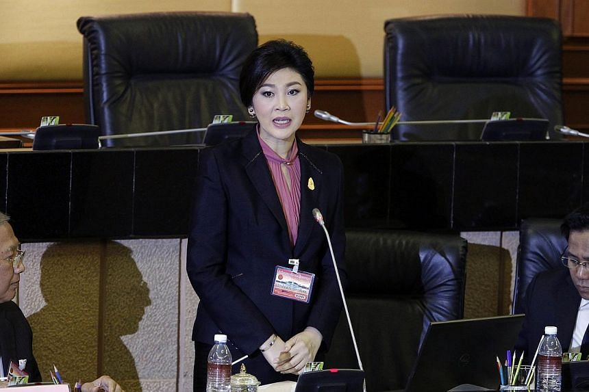 Ousted former Prime Minister Yingluck Shinawatra (centre) delivers her opening statement to the military-appointed National Legislative Assembly in Bangkok on Jan 9, 2015. Ms Yingluck denied all charges against her on Friday, at the start of impeachm