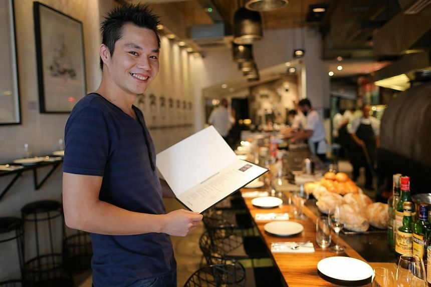 """At Australian barbecue restaurant Burnt Ends, """"No Service Charge"""" is printed on the menu. Manager Thomas Koh hopes that waiving the service charge will change the """"big fat lie in the industry""""."""