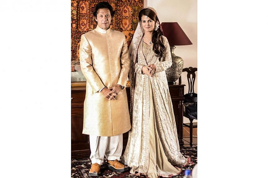 A handout picture released by the opposition political party Pakistan Tehrik-e-Insaf shows Imran Khan with his bride Reham Khan at his home in Islamabad, Pakistan, on Jan 8, 2015.-- PHOTO:EPA/PTI HANDOUT