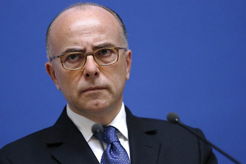French interior minister Bernard Cazeneuve said he would host an international meeting Sunday for his counterparts from the United States and Europe to discuss the battle against terrorism in the wake of the Paris magazine massacre. -- PHOTO: AF