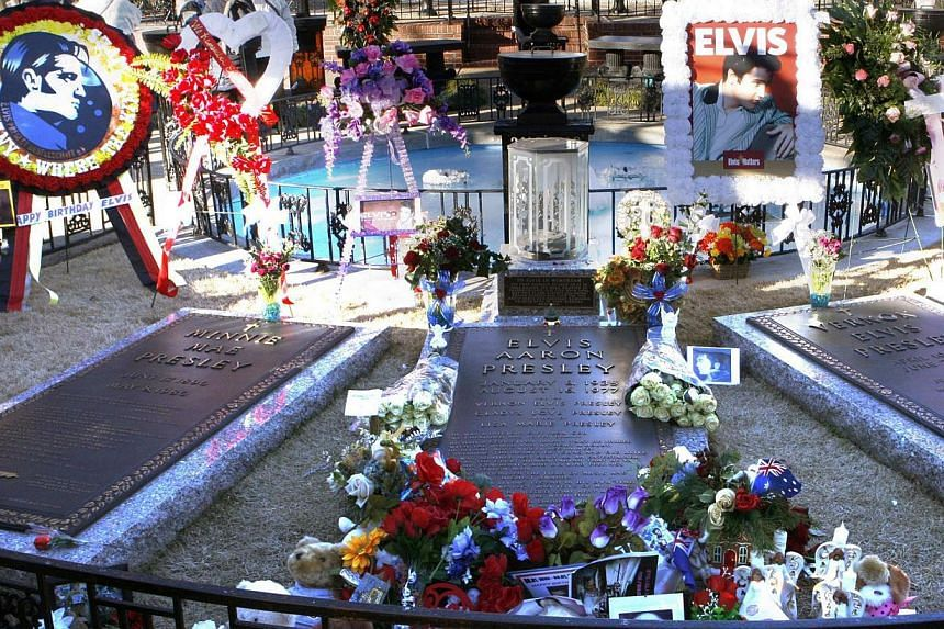 Flowers and birthday wishes from around the world lie beside the grave of Elvis Presley at his home at Graceland in Memphis, Tennessee on Jan 8, 2015. -- PHOTO: REUTERS