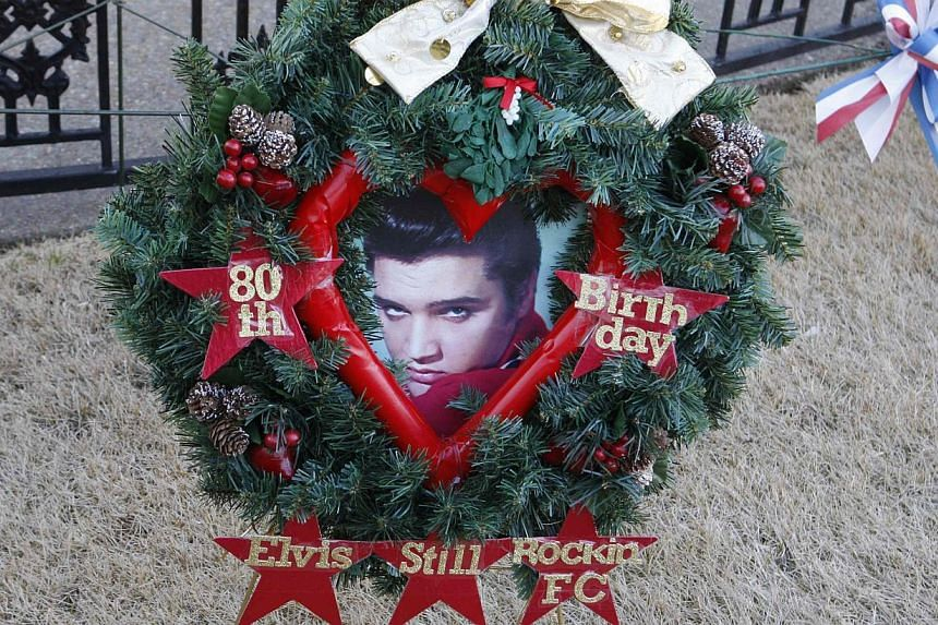 A wreath commemorating what would have been Elvis Presley's 80th Birthday sits by the grave of the late singer at his home at Graceland in Memphis, Tennessee, on Jan 8, 2015. -- PHOTO: REUTERS