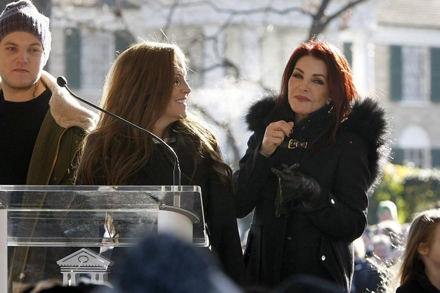 Priscilla Ann Presley, the ex-wife of the late singer Elvis Presley, stands in front of Graceland with her daughter Lisa Marie (centre) and her grandson, Ben Keough, during a proclamation of Elvis Presley Day by Memphis and Shelby County officials at