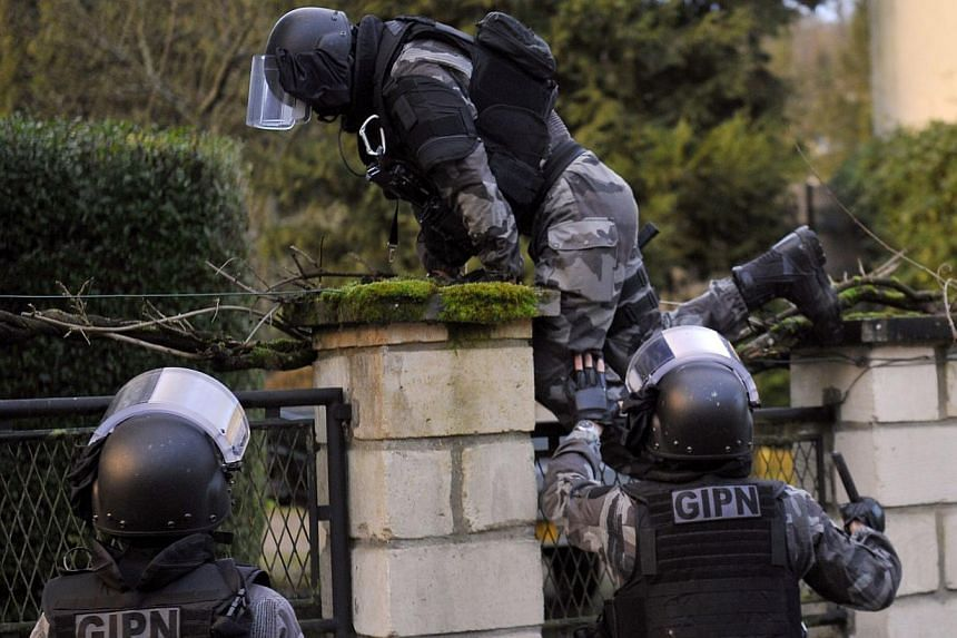 Members of the French police special force GIPN carrying out searches in Corcy, northern France, on Jan 8, 2015, during a manhunt for suspects in the deadly attack on the Paris offices of French satirical weekly Charlie Hebdo. -- PHOTO: AFP