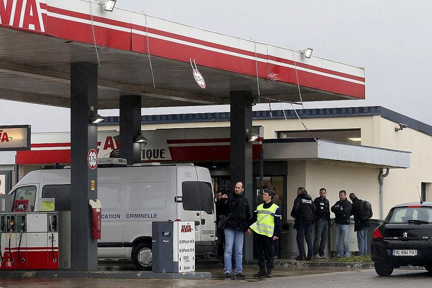 A Gendarmerie criminal identification van is parked in front of an Avia gas station in Villers-Cotterets, north-east of Paris, as police investigate on Jan 8, 2015, where the two armed suspects from the attack on French satirical weekly newspaper Cha