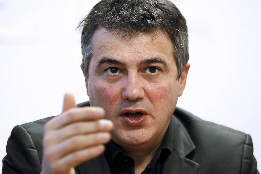"""Charlie Hebdo columnist Patrick Pelloux (above)on Thursday described the horrific scene that greeted him after his colleagues were shot dead at the French satirical newspaper's office and said """"I couldn't save them"""". -- PHOTO: AFP"""