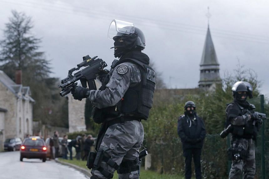 Members of the French GIPN intervention police forces secure a neighbourhood in Corcy, north-east of Paris Jan 8, 2015. -- PHOTO: REUTERS