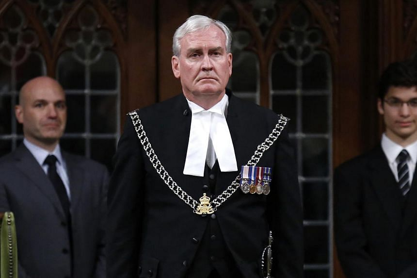 Canada's Sergeant-at-Arms Kevin Vickers is applauded in the House of Commons in Ottawa, in this file photo taken Oct 23, 2014. Hewill be named ambassador to Ireland, the government announced on Thursday. -- PHOTO: REUTERS