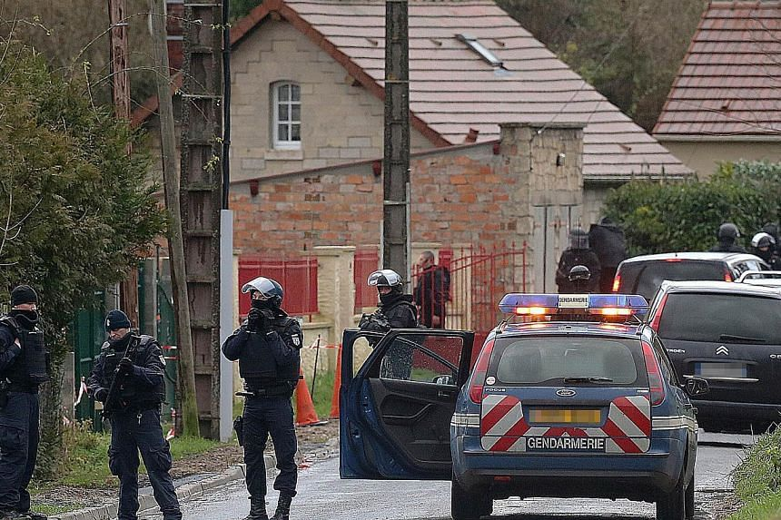 Members of GIPN and of RAID, French police special forces, are pictured in Corcy, near Villers-Cotterets, north-east of Paris, on Jan 8, 2015, where the two armed suspects from the attack on French satirical weekly newspaper Charlie Hebdo were spotte