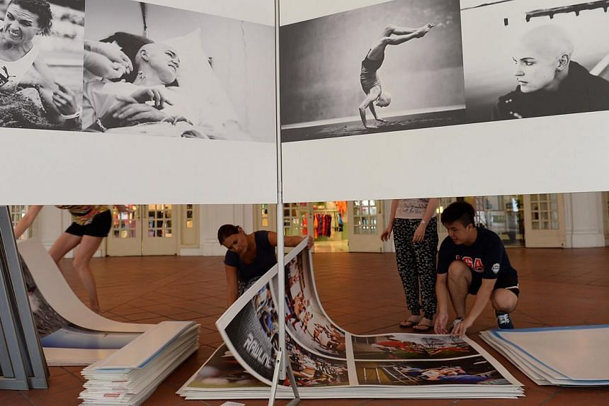 Photos being prepared for the World Press Photo Exhibition at the Raffles Hotel on 8 Jan 2015. -- ST PHOTO: STEPHANIE YEOW