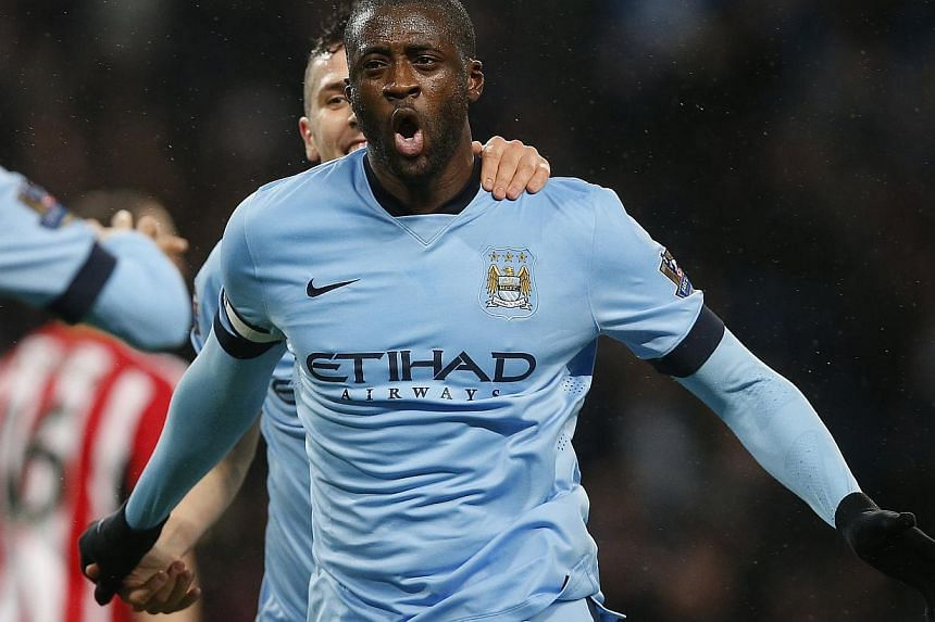 Manchester City's Yaya Toure celebrates after scoring the opening goal during their English Premier League soccer match against Sunderland at the Etihad Stadium in Manchester, northern England January 1, 2015. -- PHOTO: REUTERS