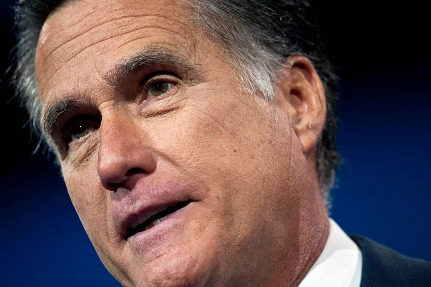 Former Republican Presidential candidate Mitt Romney (above) has said he is mulling another presidential bid.--PHOTO: AFP