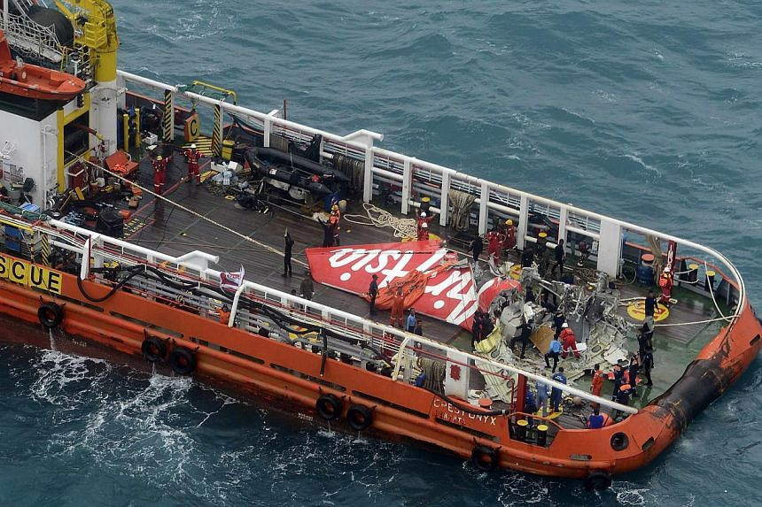 The tail of AirAsia QZ8501 passenger plane is seen on the deck of the Indonesian Search and Rescue (BASARNAS) ship Crest Onyx after it was lifted from the sea bed, south of Pangkalan Bun, Central Kalimantan on  Jan 10, 2015. -- PHOTO: REUTE