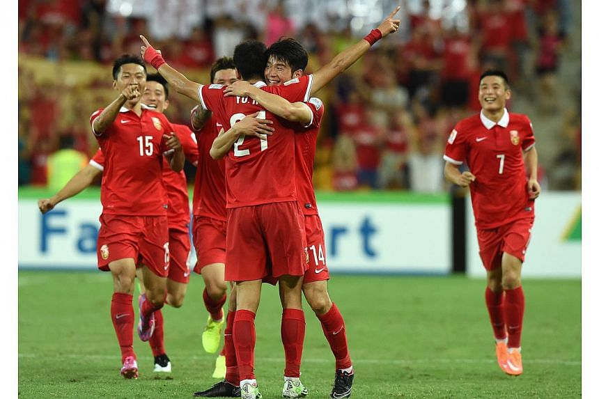 China's Yu Hai (centre) reacts after scoring a second half goal during the Group B Asian Cup match between the Kingdom of Saudi Arabia and the People's Republic of China at Brisbane Stadium in Brisbane, Australia on Saturday, Jan 10, 2015. -- PHOTO:
