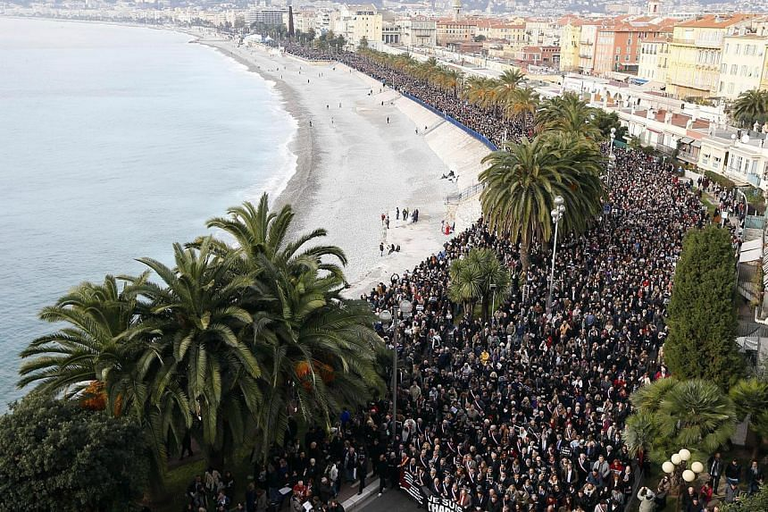 Hundreds of thousands of people march during a rally along the sea front in Nice on Jan 10, 2015, in remembrance for the victims of an attack by armed gunmen on the offices of French satirical newspaper Charlie Hebdo in Paris on Jan 7 which left at l